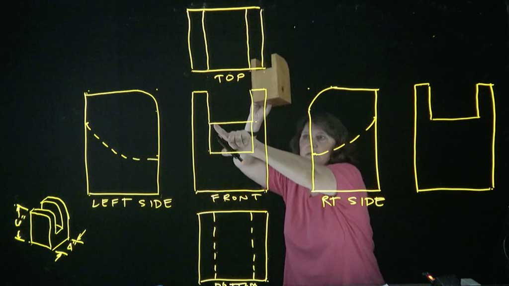 Instructor writing on a lightboard with neon dry-erase markers